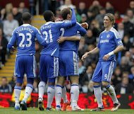 Chelsea&#39;s Branislav Ivanovic (2nd R) celebrates scoring during their Premier League match against Aston Villa, at Villa Park in Birmingham, on March 31. Chelsea&#39;s achievement in reaching the Champions League semi-finals will be put to one side when they continue their bid to break into the Premier League top four against Wigan at Stamford Bridge on Saturday