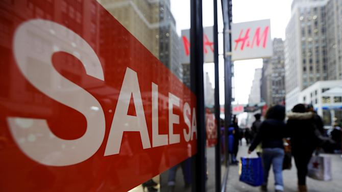 Shoppers walk past an H&M location, Wednesday, Dec. 26, 2012, in New York. This holiday season is shaping up to be the weakest since the country was in the middle of a deep recession in 2008. That not only shows that stores misread Americans' willingness to spend during this period of economic uncertainty. It also could indicate that the days of throngs of shoppers spending thousands of dollars willy nilly on holiday gifts may be long gone. (AP Photo/Frank Franklin II)