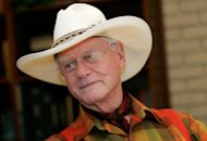 In this Thursday, Oct. 9, 2008 photo, actor Larry Hagman listens to a reporter&#39;s question while visiting the Southfork Ranch in Parker, Texas, made famous in the television show &quot;Dallas.&quot; Actor Larry Hagman, who for more than a decade played villainous patriarch JR Ewing in the TV soap Dallas, has died at the age of 81, his family said Saturday Nov. 24, 2012(AP Photo/Tony Gutierrez)