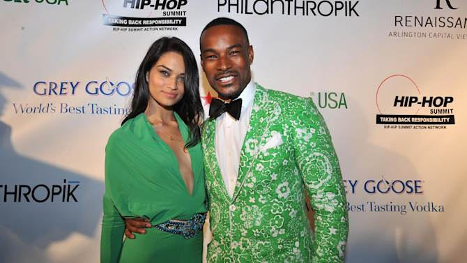 Tyson Beckford, right, and guest are seen at the Hip-Hop Inaugural Ball on Sunday, Jan. 20, 2013 in Washington. (Photo by Larry French/Invision/AP)