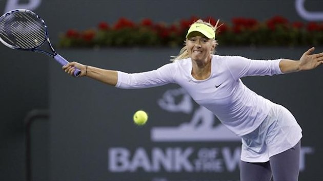 Maria Sharapova of Russia lunges for a shot against Francesca Schiavone of Italy during their match at the BNP Paribas Open (Reuters)