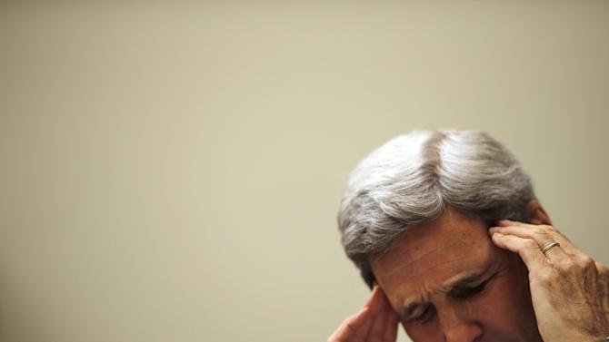 U.S. Secretary of State John Kerry pauses as he testify before a House Foreign Affairs Committee hearing on the Iran nuclear agreement in Washington