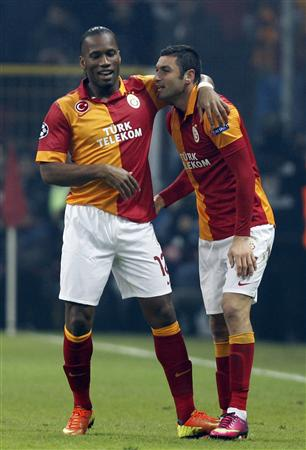 Galatasaray's Yilmaz celebrates his goal against Schalke 04 with team mate Drogba during their Champions League soccer match in Istanbul