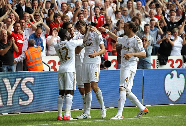 Miguel Michu, centre, scored Swansea's second goal
