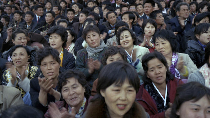 In this April 15, 2012 photo, North Koreans gather along the banks of the Taedong River in Pyongyang to watch a fireworks display to celebrate 100 years since the birth of the late North Korean founder Kim Il Sung. (AP Photo/David Guttenfelder)