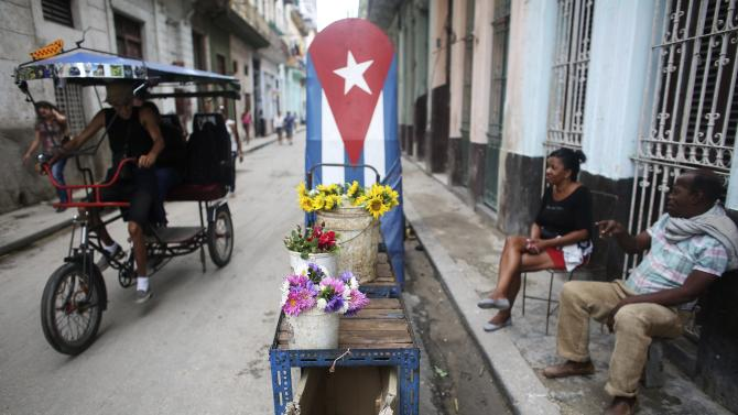 Pedro Paterson sells flowers in downtown Havana