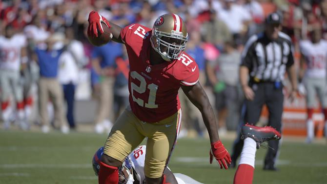 San Francisco 49ers running back Frank Gore (21) gets past New York Giants defensive end Jason Pierre-Paul (90) during the first quarter of an NFL football game in San Francisco, Sunday, Oct. 14, 2012. (AP Photo/Mark J. Terrill)