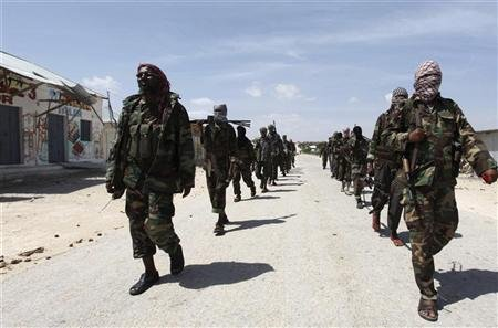 Al Shabaab soldiers patrol in a formation along the streets of Dayniile district in Southern Mogadishu