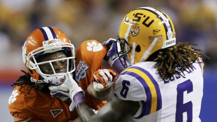 Clemson wide receiver DeAndre Hopkins (6) clashes with LSU safety Craig Loston (6) during the first half of the Chick-fil-A Bowl NCAA college football game, Monday, Dec. 31, 2012, in Atlanta. (AP Photo/David Goldman)