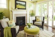 Green is the bold accent color in this cozy sitting area.
