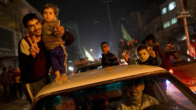 Palestinians celebrate the Israel-Hamas cease-fire in Gaza City, Wednesday, Nov. 21, 2012. Israel and the Hamas militant group agreed to a cease-fire Wednesday to end eight days of the fiercest fighting in nearly four years, promising to halt attacks on each other and ease an Israeli blockade constricting the Gaza Strip. (AP Photo/Bernat Armangue)