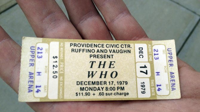 Rick Mayer, 55, of Medfield, Mass. , holds a ticket for a canceled 1979 concert by The Who at the Dunkin Donuts Center in Providence, R.I., Tuesday, July 31, 2012. Mayer was among fans who redeemed tickets from a canceled 1979 show, for The Who's Quadrophenia show set to play there in February 2013. Their 1979 concert was cancelled due to safety concerns after 11 people died in a stampede before a show in Ohio.  (AP Photo/Michelle R. Smith)