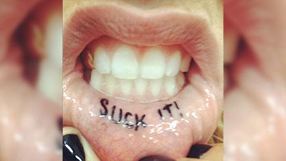 Say What?! Kesha Gets 'Suck It' Tattoo on Lip