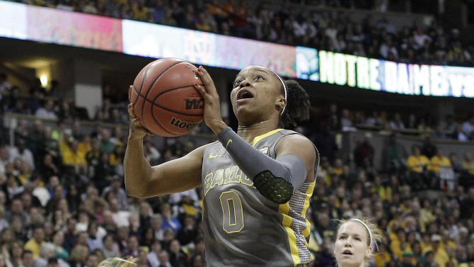 Baylor guard Odyssey Sims (0) heads to the hoop as Notre Dame guard Brittany Mallory (22) and Notre Dame guard Natalie Novosel (21) look on during the first half in the NCAA women's Final Four college basketball championship game, in Denver, Tuesday, April 3, 2012.  (AP Photo/Eric Gay)