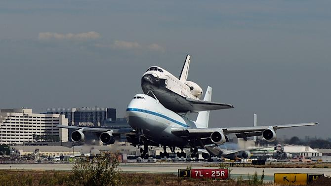 The Space Shuttle Endeavour atop a modified 747  lands at Los Angeles International Airport on Friday, Sept. 21, 2012 in Los Angeles, Endeavour will be permanently displayed at the California Science Center in Los Angeles. (AP Photo/Kevork Djansezian, Pool)
