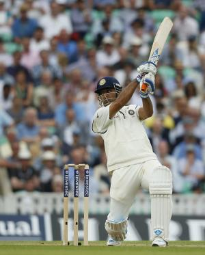 India's MS Dhoni hits out off the bowling of England's Chris Jordan during the first day of the fifth Test cricket match at Oval cricket ground in London, Friday, Aug. 15, 2014. (AP Photo/Alastair Grant)