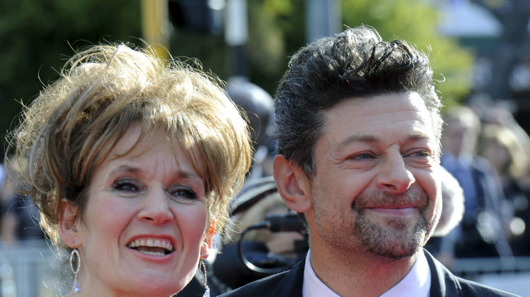 "Cast member Andy Serkis, right, and his wife Loraine Ashbourne pose on the red carpet at the premiere of ""The Hobbit: An Unexpected Journey,""  at the Embassy Theatre, in Wellington, New Zealand, Wednesday, Nov. 28, 2012.  (AP Photo/SNPA, Ross Setford) NEW ZEALAND OUT"