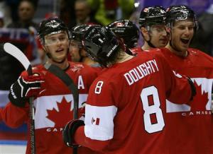 Canada's Doughty celebrates his game winning overtime goal against Finland with teammates during their men's preliminary round ice hockey game at the Sochi 2014 Winter Olympic Games