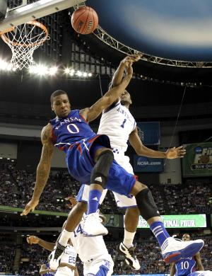 Kansas forward Thomas Robinson (0) and Kentucky guard Darius Miller (1) battle for the ball during the first half of the NCAA Final Four tournament college basketball championship game Monday, April 2, 2012, in New Orleans. (AP Photo/David J. Phillip)