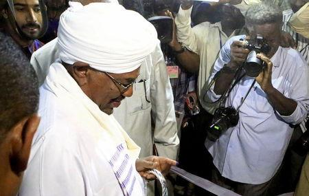 Sudan's President Al-Bashir casts his ballot during elections in the capital Khartoum