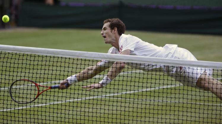 Andy Murray of Britain dives for a shot to Jo-Wilfried Tsonga of France during a men's semifinals match at the All England Lawn Tennis Championships at Wimbledon, England, Friday, July 6, 2012. (AP Photo/Alastair Grant)
