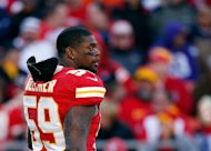 Inside linebacker Jovan Belcher of the Kansas City Chiefs walks off the field during his final game, against the Denver Broncos on November 25, 2012. Days later Belcher used a .40-calibre handgun to kill his girlfriend, Kasandra Perkins, in their home. Belcher then drove to the Chiefs' Arrowhead Stadium, where he used a different handgun to kill himself