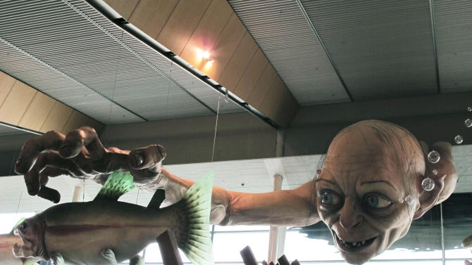 """In this photo taken Saturday, Nov. 24, 2012, a giant sculpture of Gollum, a character from """"The Hobbit,"""" is displayed in the Wellington Airport to celebrate the upcoming premiere of the first movie in the trilogy, in Wellington, New Zealand. The sculpture was created at Weta Workshop, part of Peter Jackson's movie empire in the Wellington suburb of Miramar. The world premiere of """"The Hobbit: An Unexpected Journey"""" is Nov. 28 at Wellington's Embassy Theatre. (AP Photo/Nick Perry)"""