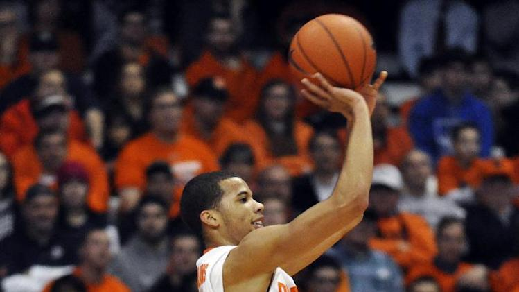 Syracuse's Michael Carter-Williams shoots from the corner against Rutgers during the first half of an NCAA college basketball game in Syracuse, N.Y., Wednesday, Jan. 2, 2013. (AP Photo/Kevin Rivoli)