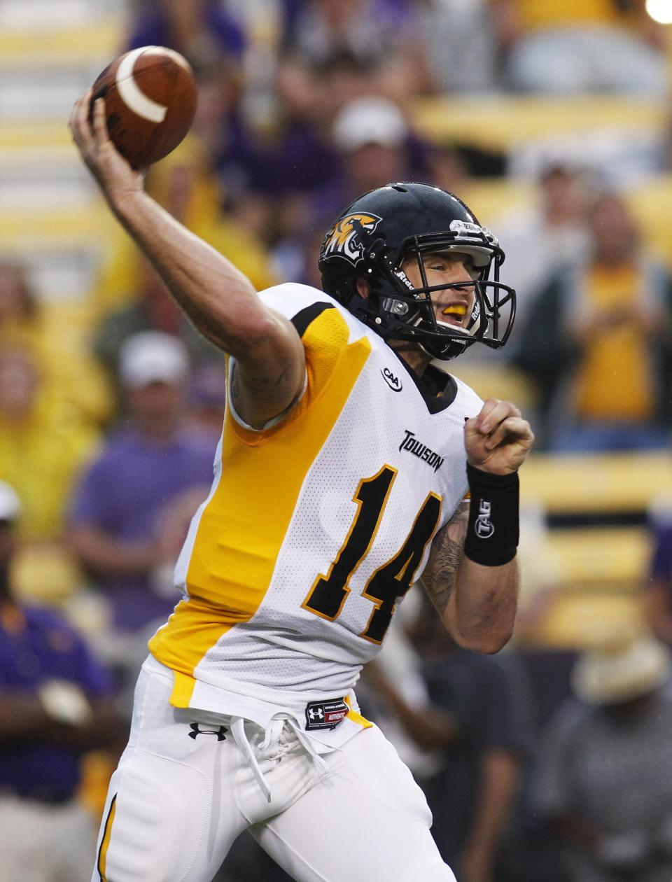 Towson quarterback Grant Enders throws a pass against LSU in the first half of an NCAA college football game in Baton Rouge, La., Saturday, Sept. 29, 2012. (AP Photo/Bill Haber)