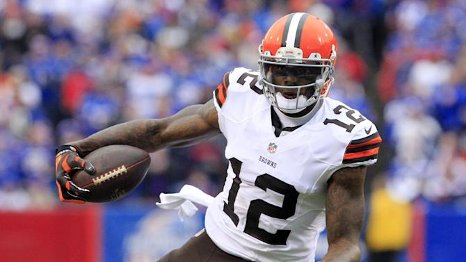 FILE - In this Nov. 30, 2014, file photo, Cleveland Browns wide receiver Josh Gordon (12) carries the ball after a reception against the Buffalo Bills during the first half of an NFL football game in Orchard Park, N.Y. The Browns suspended Gordon on Saturday, Dec. 27, 2014, for a violation of team rules one day before the season finale at Baltimore. (AP Photo/Bill Wippert, File)