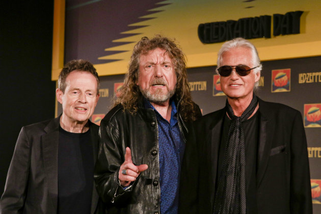 Bassist and keyboardist John Paul Jones, from left, frontman Robert Plant and guitarist Jimmy Page appear at a media screening ahead of the worldwide theatrical release of Led Zeppelin's 2007 Celebration Day concert at the O2, on Friday, Sept. 21, 2012 in London. (Photo by Miles Willis/Invision/AP)