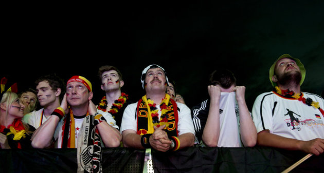 German Fans Hold National Flags Reacts On June 13, 2012 Near The Brandenburg Gate In Berlin,  AFP PHOTO / JOHN AFP/Getty Images