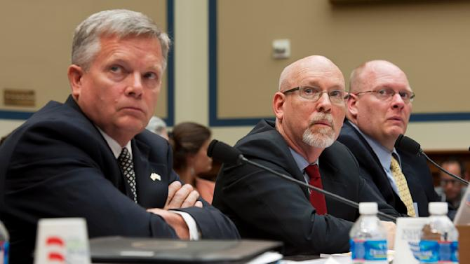 Mark Thompson, Acting Deputy Assistant Secretary for Counterterrorism, left, Gregory Hicks, former Deputy Chief of Mission in Libya, center, and Eric Nordstrom, Diplomatic Security Officer and former Regional Security Officer in Libya, right, testify before the House Oversight and Government Reform Committee's hearing on Benghazi: Exposing Failure and Recognizing Courage on Capitol Hill in Washington, Wednesday, May 8, 2013. (AP Photo/Cliff Owen)