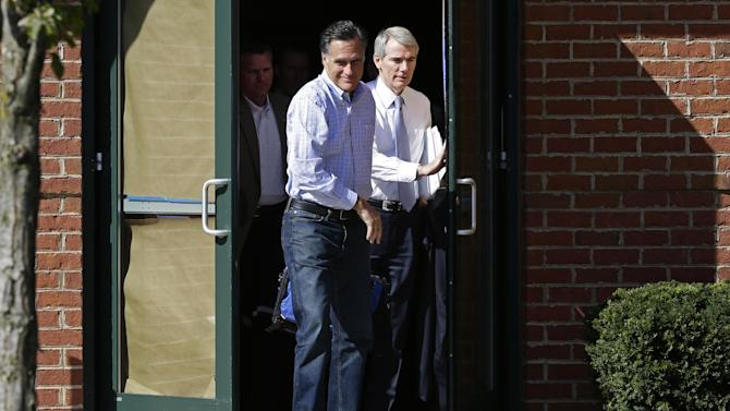 Republican presidential candidate and former Massachusetts Gov. Mitt Romney and Sen. Rob Portman, R-Ohio, emerge from debate preparation at a hotel in Columbus, Ohio, Saturday, Oct. 13, 2012. (AP Photo/Charles Dharapak)