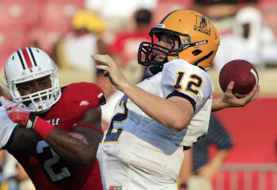 Murray State's Casey Brockman readies a pass during the first half of an NCAA college football game against Louisville, Thursday, Sept. 1, 2011, in Louisville, Ky. (AP Photo/Ed Reinke)