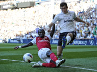Tottenham Hotspur's Gareth Bale, right, crosses the ball past Arsenal's Bacary Sagna during their English Premier League soccer match at White Hart Lane stadium, London, Sunday, Oct. 2, 2011. (AP Photo/Tom Hevezi)