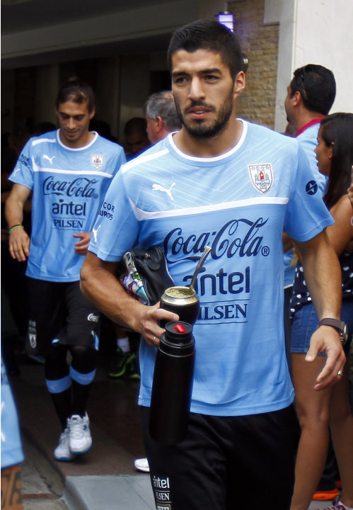 Uruguay's Suarez walks out of the hotel before their training session in Puerto Ordaz