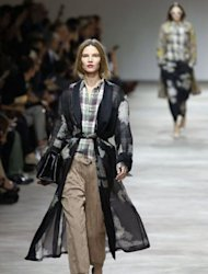 Models present creations by Dries Van Noten at Paris Fashion Week. Tartan checks, boxy shorts and perfecto jackets met sheer silks and fluid silhouettes as designers played a boy-girl game with their looks for next spring