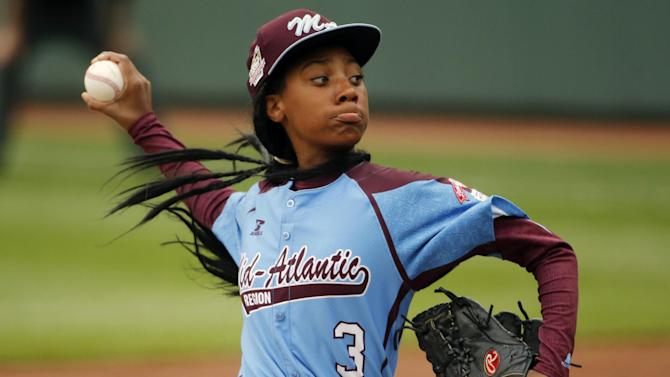 FILE - In this Aug. 15, 2014 file photo, Pennsylvania's Mo'ne Davis delivers in the fifth inning against Tennessee during a baseball game in United States pool play at the Little League World Series tournament in South Williamsport, Pa. Pennsylvania won 4-0 with Davis pitching a complete game two-hit shutout. (AP Photo/Gene J. Puskar, File)