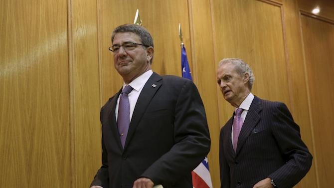 U.S. Defense Secretary Ash Carter arrives with his Spanish counterpart Pedro Morenes during a conference in Madrid, Spain