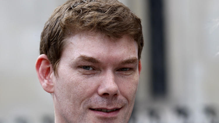 File - In this July 14, 2009 file photo Gary McKinnon, accused of hacking into U.S. military computers and facing extradition to the U.S. to stand trial, leaves the High Court in London. British authorities say Friday Dec 14 2012 they've opted not to charge the computer hacker who waged a decade-long struggle to avoid trial in the U.S. Prosecutors had to decide whether Gary McKinnon should be tried in Britain over alleged breaches of military and NASA networks, after he successfully fought extradition to the United States. (AP Photo/Sang Tan, File)