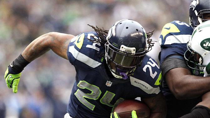 Seattle Seahawks' Marshawn Lynch (24) rushes to the one-yard line on a carry late in the first half of an NFL football game against the New York Jets, Sunday, Nov. 11, 2012, in Seattle. Lynch scored two plays later. (AP Photo/Elaine Thompson)