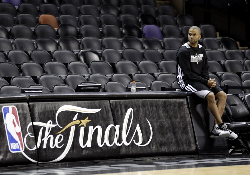San Antonio Spurs' Tony Parker watches from the sideline during NBA basketball practice Wednesday, June 12, 2013, in San Antonio. The Spurs lead the Miami Heat 2-1 in the best-of-seven games series. Game 4 of the NBA finals series is scheduled for Thursday. (AP Photo/David J. Phillip)