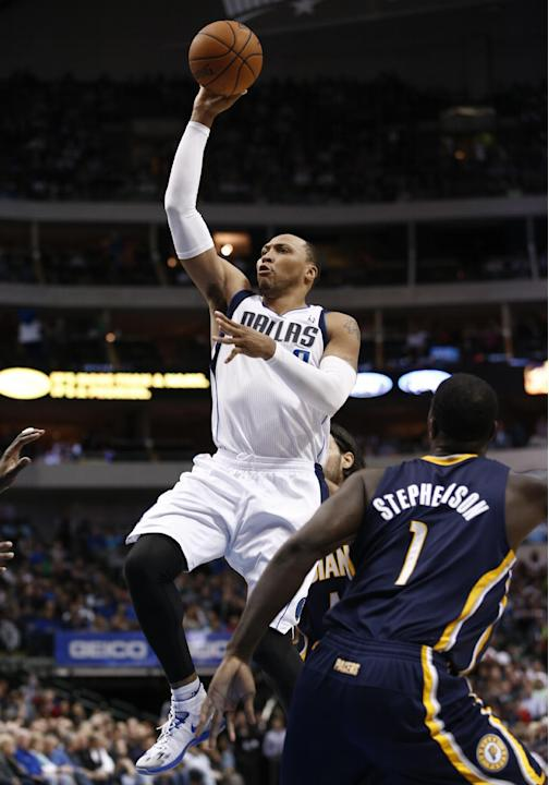 Dallas Mavericks small forward Shawn Marion (0) shoots the ball in front of Indiana Pacers' Lance Stephenson (1) 2during the first half of an NBA game, Sunday, Mar. 9, 2014, in Dallas, Texas