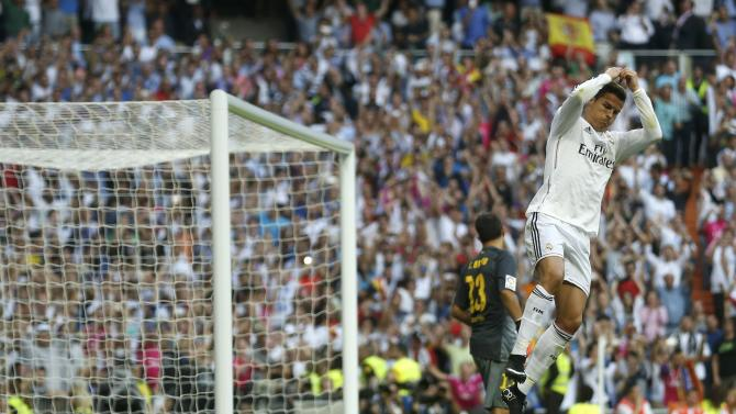 "Real Madrid's Ronaldo celebrates after scoring against Barcelona during their Spanish first division ""Clasico"" soccer match at the Santiago Bernabeu stadium in Madrid"