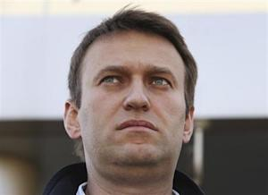 Russian opposition leader Alexei Navalny speaks to journalists outside a court in Moscow