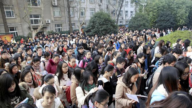 Participants enter a site to attend the annual national public service examination, in Nanjing
