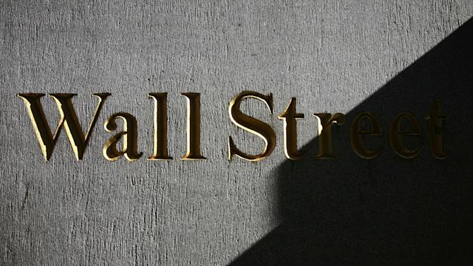 Stocks end lower as traders sell blue chips
