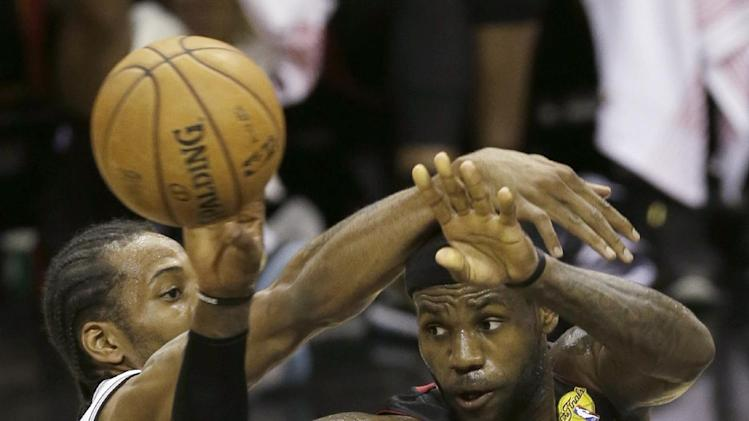 Miami Heat's LeBron James looks to pass against San Antonio Spurs' Kawhi Leonard (2) during the first half at Game 4 of the NBA Finals basketball series, Thursday, June 13, 2013, in San Antonio. (AP Photo/David J. Phillip)
