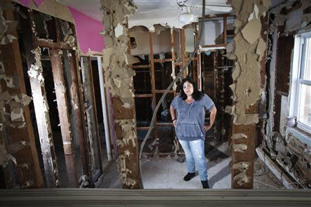 Nicole Chati poses for a portrait in what was her daughter's room after her home was damaged by Superstorm Sandy in the Staten Island borough of New York